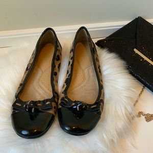 Leopard print captoe flats with leather bows